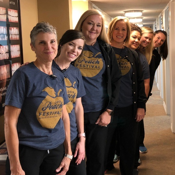 the dental team at Beacon Dentistry in Weatherford wearing Peach Festival shirts